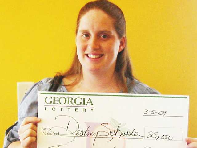 Midway mommy-to-be wins $25,000 - Coastal Courier