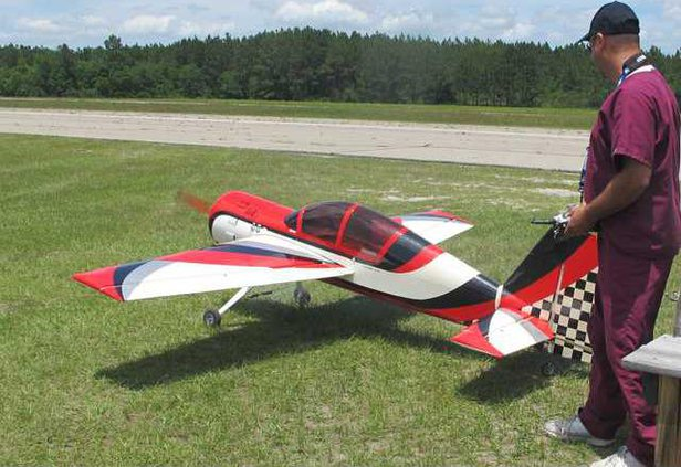 Dr. Dan Green preps  model plane for take-off