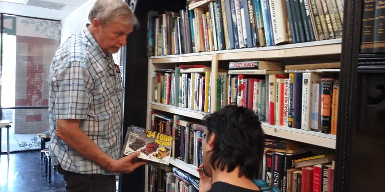 book store 2 Owner David O'Coin (left) with customer Stephen Beasley.jpg